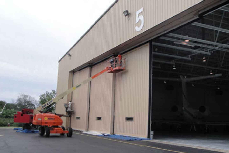 Exterior Painting of Airplane Hangar Building