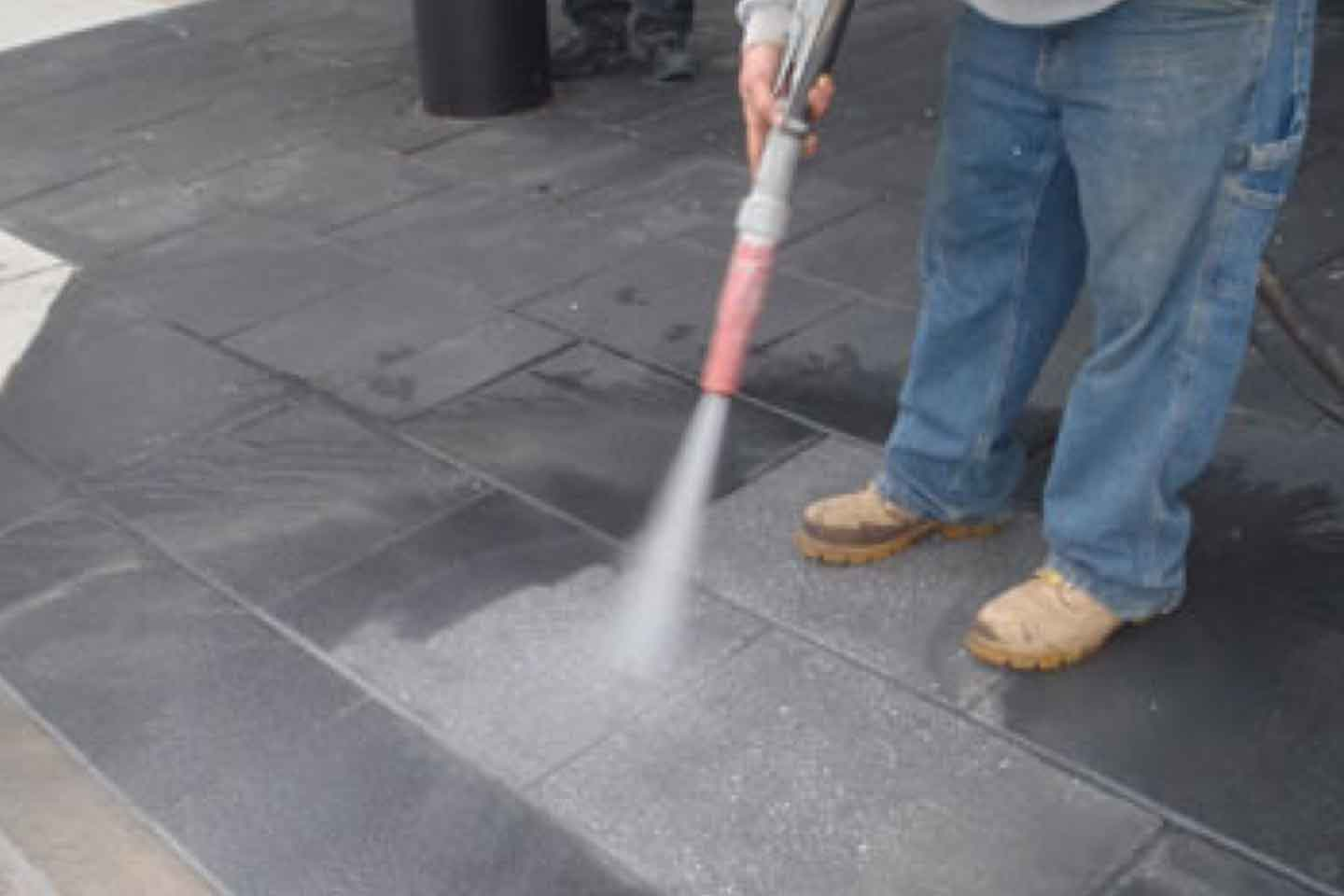Coating Removal from Concrete Pavers utilizing Farrow System